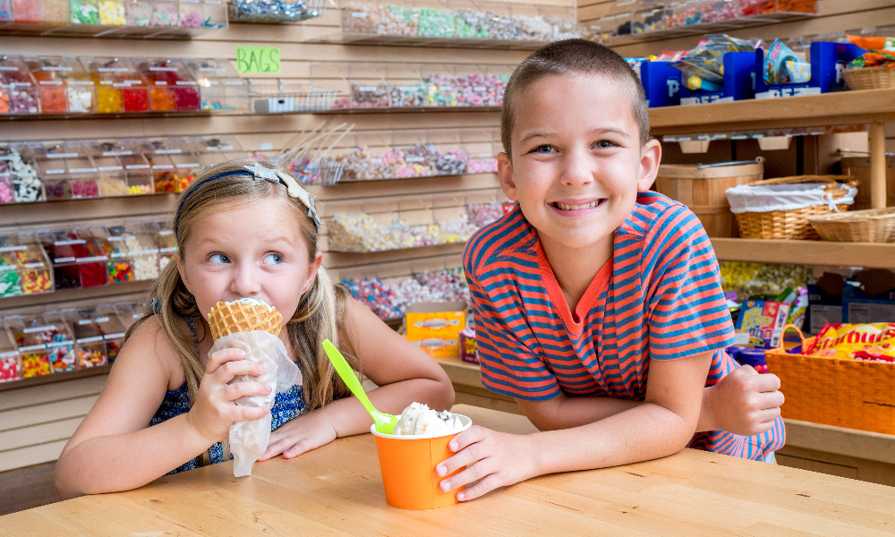 Boy and girl eating ice cream